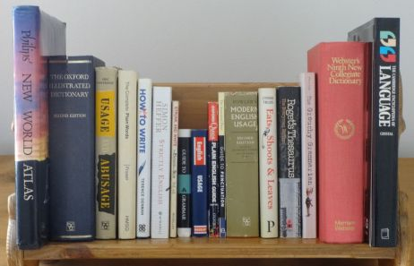 My bookshelf containing many books on English grammar
